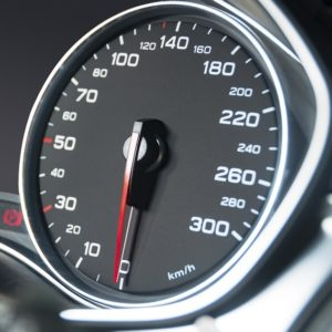 Car speedometer dashboard which if you notice revving when you accelerate but you aren't accelerating, your transmission is slipping